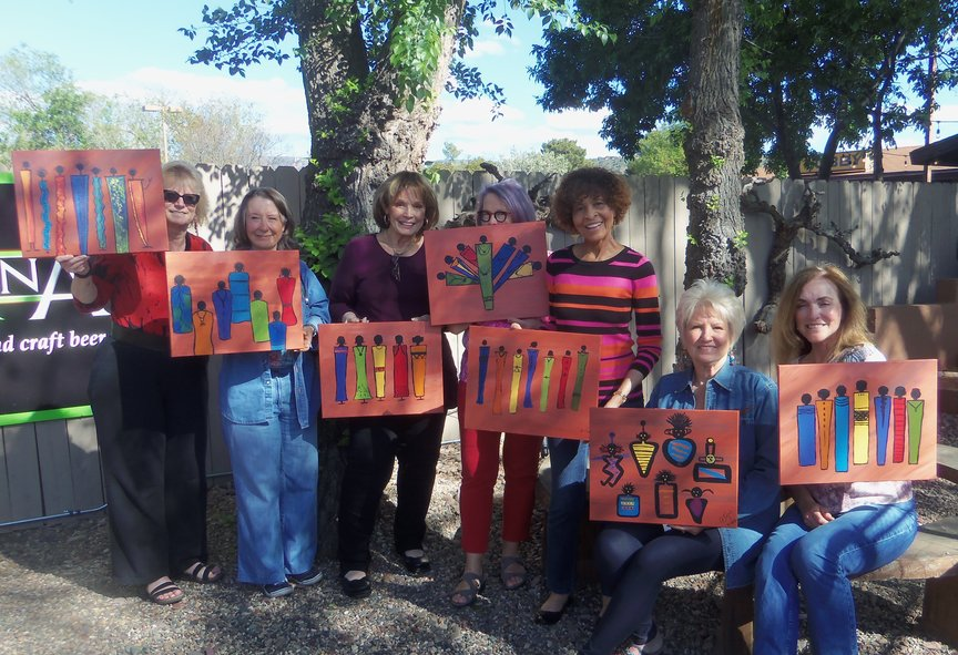 Sedona Book Club having fun at Vino Di Sedona during an afternoon paint-along event.