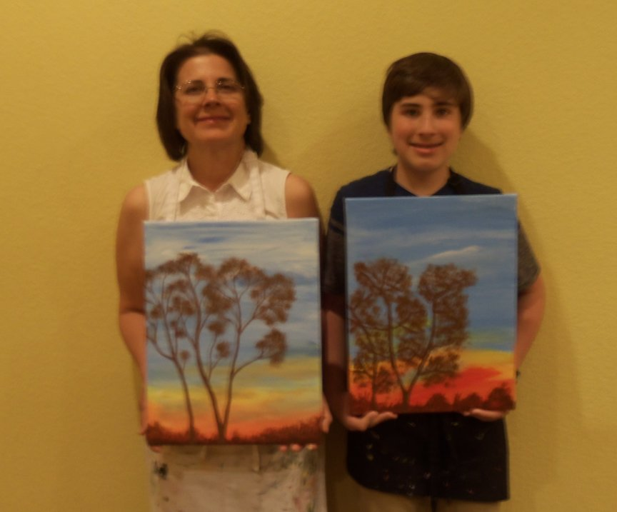 Learning to blend the colors of the sunset with acrylics at Paint Along For Fun