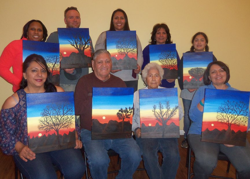Family painting together in Sedona during birthday weekend celebration.